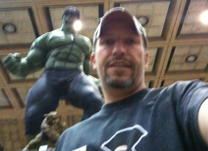Ken Drab poses for a photo with the Hulk